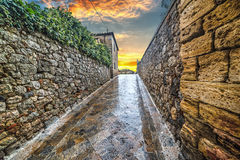 Narrow alley in Monteriggioni Stock Photography