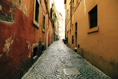 Narrow alley between old buildings Stock Images