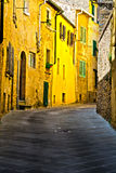 Narrow Alley. With Old Buildings in Italian City of Volterra Stock Photos