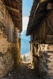 Narrow alley between old houses with mountain view stock photos
