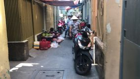 Narrow alley in old part of Ho Chi Minh, Vietnam stock video