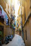 Narrow alley in old town Ciutat Vella of Barcelona. Spain Royalty Free Stock Photos