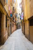 Narrow alley in old town Ciutat Vella of Barcelona. Spain Royalty Free Stock Photo
