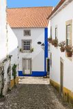 Narrow alley in the old town of Obidos, Portugal Stock Photos
