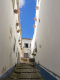 Narrow alley in the old town of Obidos, Portugal Stock Photo