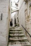 Narrow alley in Ostuni city Royalty Free Stock Photo