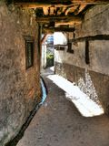 Narrow alley in rural village Royalty Free Stock Images