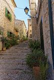 Narrow alley in spain on a sunny day with blue sky. Mallorca Europe Stock Images