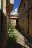 Narrow alley in spain on a sunny day with blue sky. Mallorca Europe Stock Photography