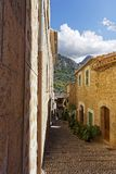 Narrow alley in spain on a sunny day with blue sky. Mallorca Europe Royalty Free Stock Photography