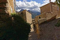 Narrow alley in spain on a sunny day with blue sky. Mallorca Europe Royalty Free Stock Image