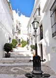 Narrow alley with stairs between white houses in a small Spanish mountain village in Andalusia, narrow street, sight, andalusia, royalty free stock image