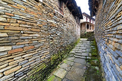 Narrow alley between stone houses Stock Photography