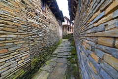 Narrow alley between stone houses Stock Photos