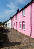 Narrow alley or street in front of colorful cottages in Boscastl Royalty Free Stock Images