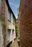 Narrow alley or street leading to parish church Royalty Free Stock Photography