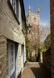 Narrow alley or street leading to parish church Stock Photography