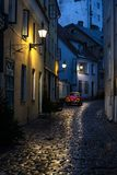Narrow alley in Tallinn old town. Night view of a narrow street in Tallinn's old town, Estonia Royalty Free Stock Image
