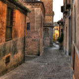 Narrow alley in Toledo (Spain). Detail of narrow cobblestone alley in Toledo (Spain royalty free stock photo
