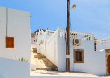 Narrow alley and traditional Greek architecture of Lindos, Rhodes Island, Greece Stock Photography