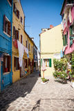 Narrow alley in Venice. Narrow alley in Burano Island, Venice royalty free stock images