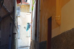 Narrow alley way in france with clothelines Stock Image