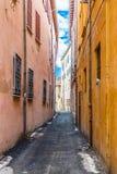 Narrow alleys between vertiginous walls of ancient buildings Royalty Free Stock Images