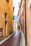 Narrow alleys between vertiginous walls of ancient buildings Stock Image