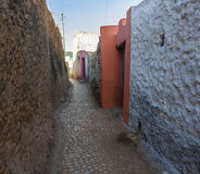 Narrow alleyway of ancient city of Jugol. Harar. Ethiopia. Narrow alleyway of ancient city of Jugol early in the morning. Harar. Ethiopia Royalty Free Stock Photos