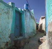 Narrow alleyway of ancient city of Jugol. Harar. Ethiopia. Narrow alleyway of ancient city of Jugol in the morning. Harar. Ethiopia Royalty Free Stock Photos