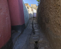 Narrow alleyway of ancient city of Jugol in the morning. Harar. Stock Photos