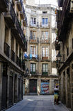 Narrow alleyway in Barcelona Stock Photo