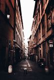 Narrow alleyway in France, Vieux Lyon with clear white bright sky stock photos