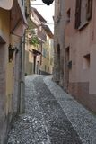 Narrow alleyway in small town  Royalty Free Stock Image