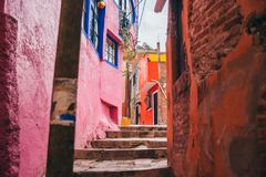 Narrow alleyway with very colorful houses on the side in Guanajuato royalty free stock photos