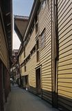 A narrow alleyway with wooden buildings in Bryggen, Bergen, Norway. Bryggen is the site of the original settlement of Bergen, and the city's best stock images