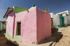 Narrow alleyways of ancient city of Jugol. Harar. Ethiopia. Pink house in narrow alleyway of ancient city of Jugol in the morning. Harar. Ethiopia Royalty Free Stock Images