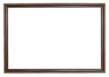 Narrow ancient dark brown wooden picture frame Stock Image
