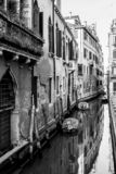 Narrow, ancient and romantic venetian canals. Venice, Italy. Black and white image