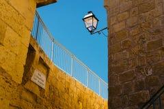 Ancient walls of Citadel, Victoria, Malta. Narrow ancient street of The Citadel, Victoria, Gozo Island Stock Photo