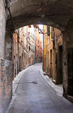 Narrow arched romantic alley in Perugia, Italy Royalty Free Stock Photography