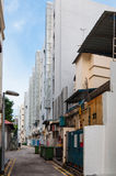 Narrow back alley in Singapore city. Grunge aged street Stock Photo