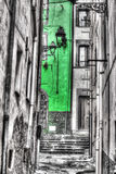 Narrow backstreet in Bosa old town in selective desaturation Royalty Free Stock Photography