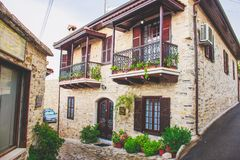 The narrow backstreet decorated with flowers in pots and green plants, Lefkara, Cyprus. stock images