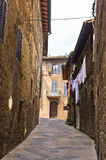 Narrow backstreets with medieval architecture at San Gimignano, Tuscany Royalty Free Stock Images