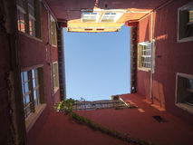 Narrow backyard sky view Stock Images