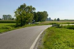Narrow bend in country road of Adda park  near Abbadia Cerreto Stock Photography