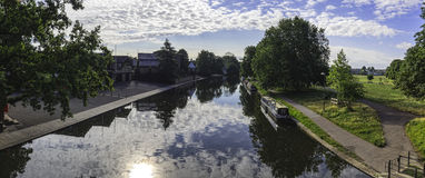 Narrow boat barge under the green trees in Cambridge Royalty Free Stock Image