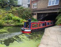 Narrow boat enters  tunnel Stock Images