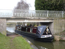 Narrow boat. Under bridge on the Trent and Mersey Canal in Cheshire UK Stock Images